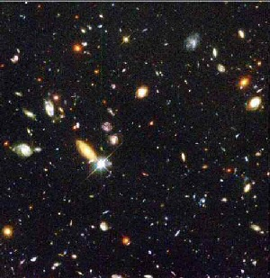 Figure 12. This picture shows a collection of galaxies indicating what the Universe might look like if we were looking in from far away.